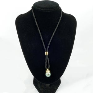 Image of Sterling silver gold plated Tahitian pearl necklace on Black silk chord.