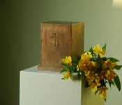 Image of Large bronze urn with small cross