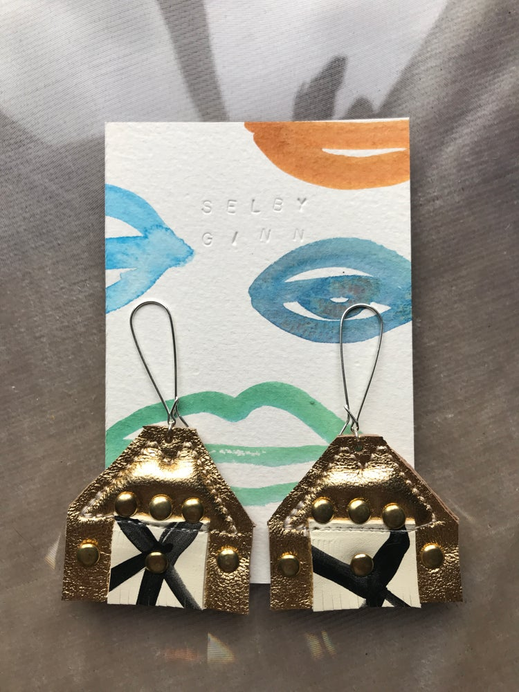 Image of Triangle earrings with blk/white and rivets