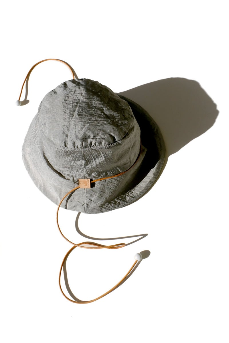 Image of reversible silver nylon bucket hat