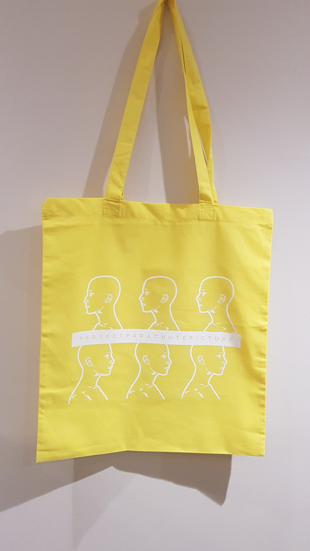 Image of 'Six Heads' Tote in Yellow