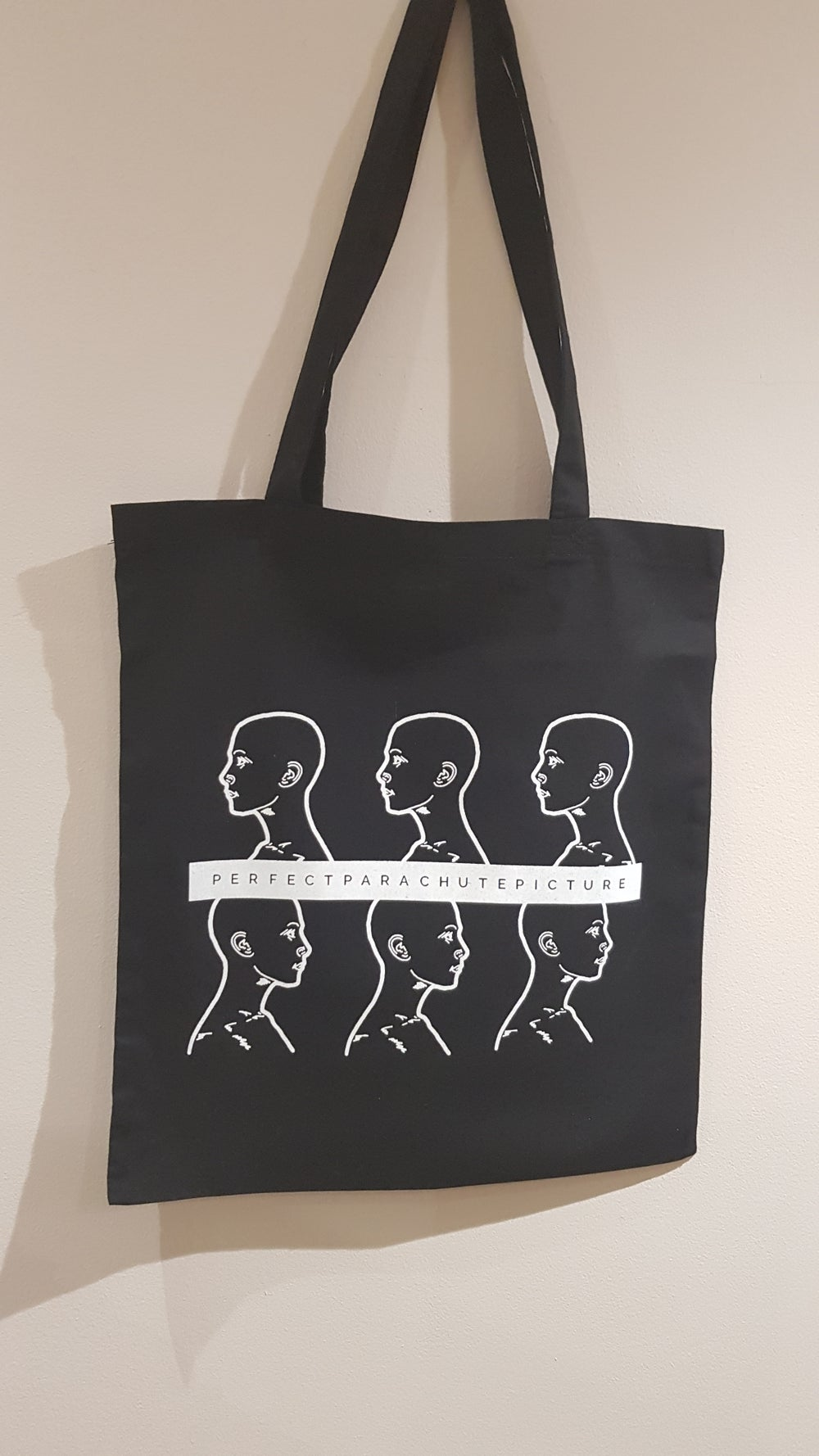 Image of 'Six Heads' Tote in Black