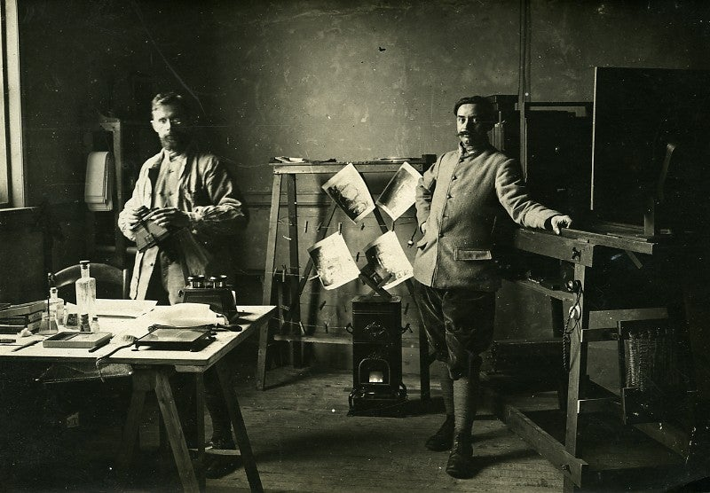 Image of WWI: two French soldiers working in a photo lab, ca. 1916