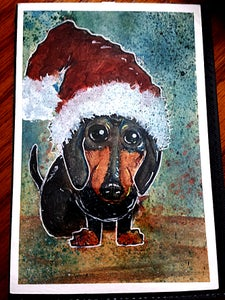 Image of Dachshund in a Santa Hat