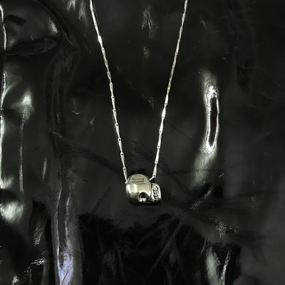 Image of skull bead on teardrop chain