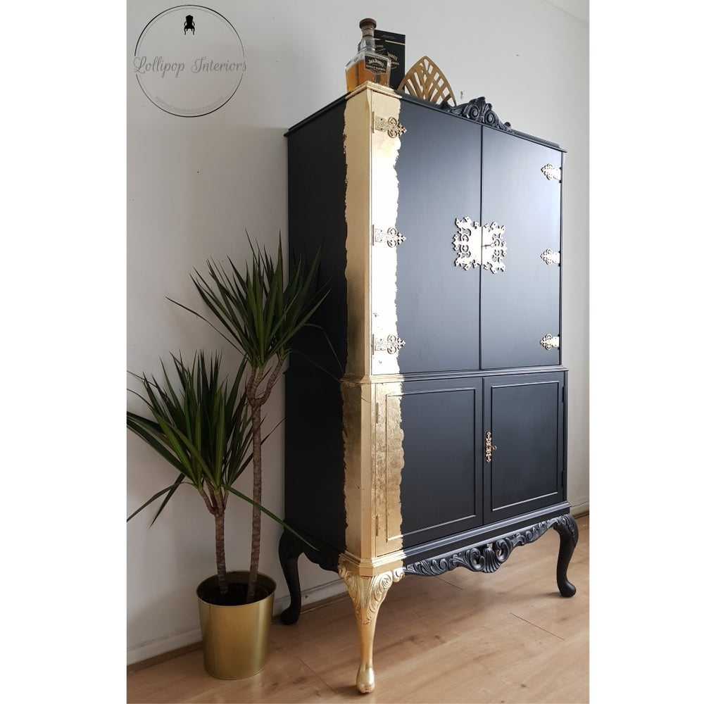 Image of Black and gold drinks cabinet