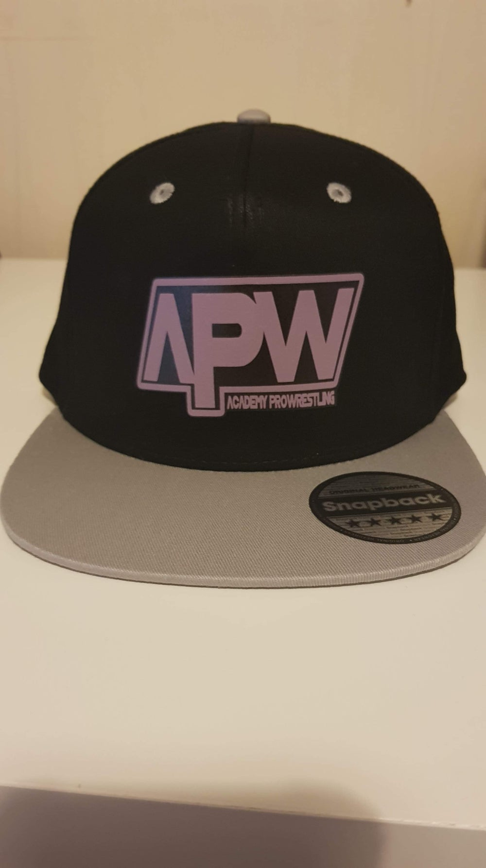 Image of APW Snap back caps
