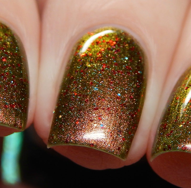 Image of ~I Saw Mommy Kissing Santa Claus~ red to gold to green multichrome w/red micro glitters and holo bit