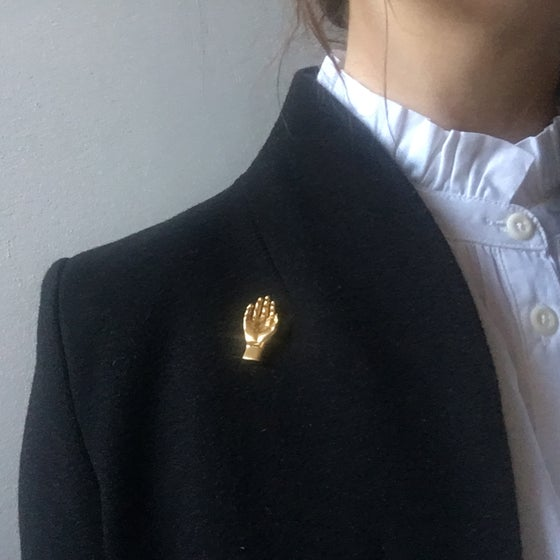 Image of hand brooch, silver and gold plated