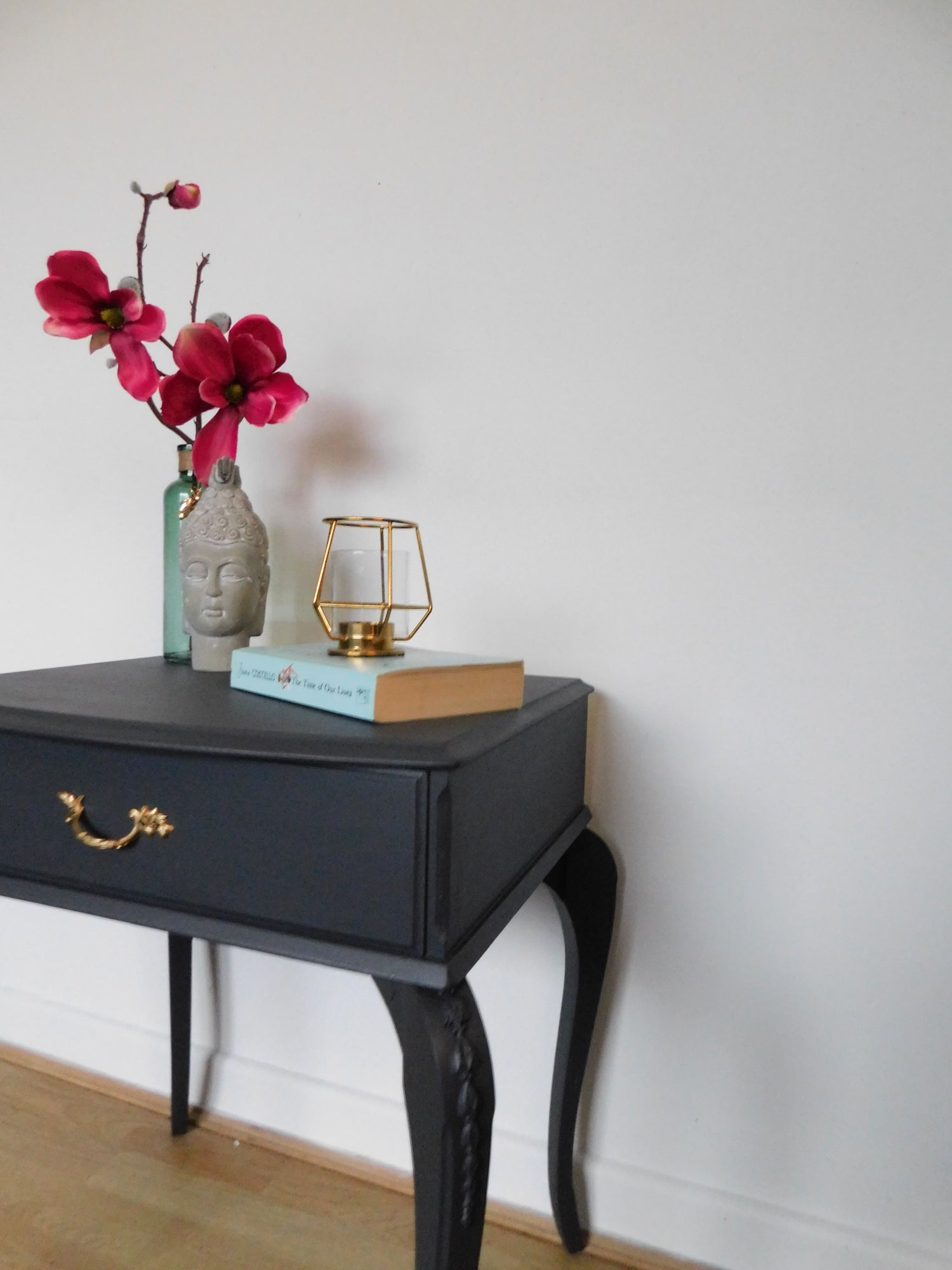 Image of A dark grey bedside table
