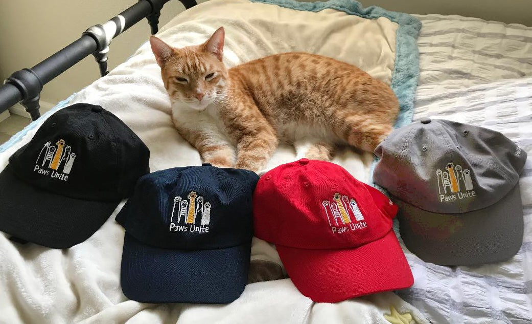 Image of Baseball cap with embroidered Paws Unite design