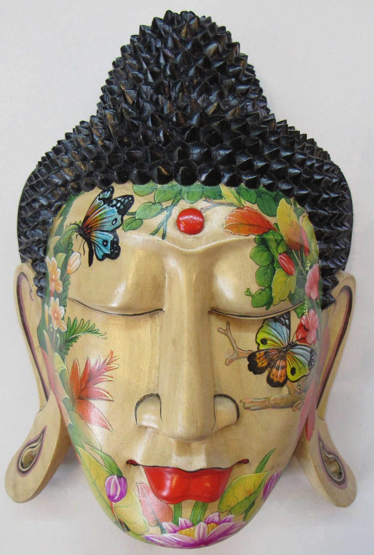 Image of Painted hibiscus wood buddha mask.