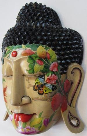 Image of Painted hibiscus wood buddha mask.