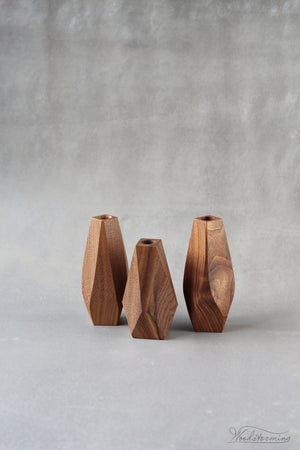 Image of A set of 3 walnut vases