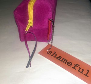 Image of NEW RANGE - Vibrant pink velvet purse with sunshine yellow zip