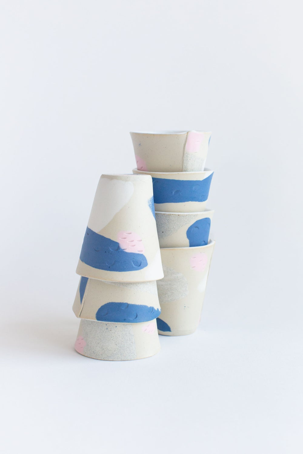 Image of Tumbler - Cobalt and bubblegum Pink porcelain inlay over a light stoneware body.