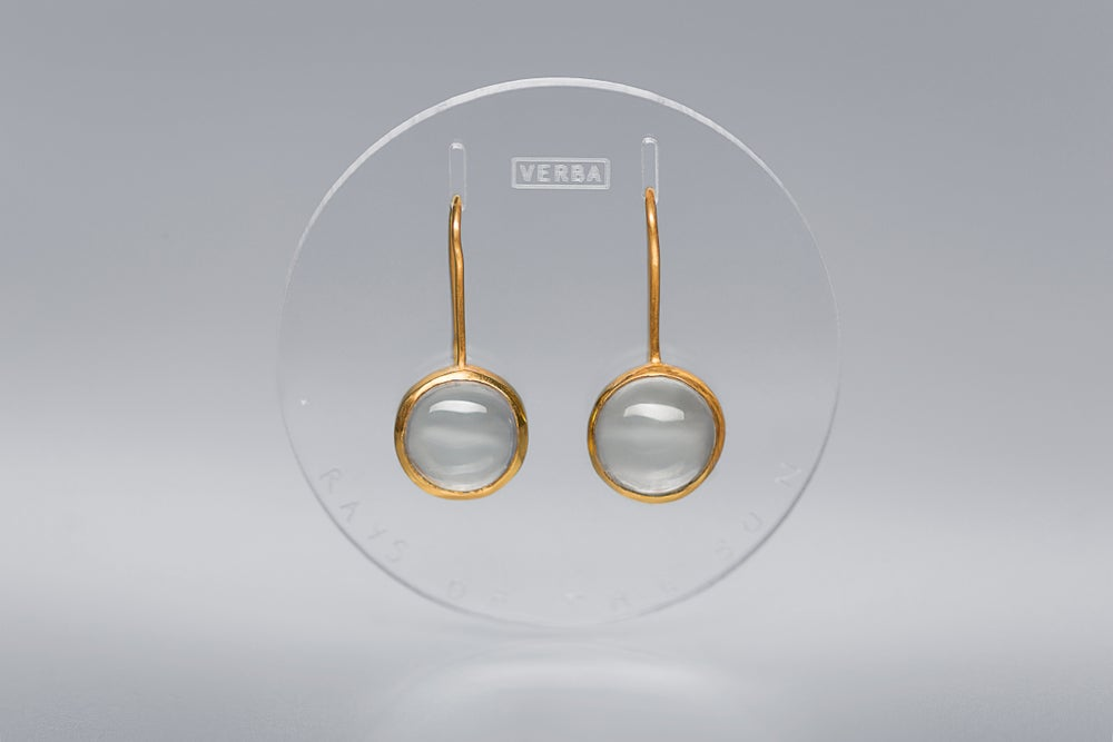 Image of gold plated silver earrings with round rock crystals RADII SOLIS