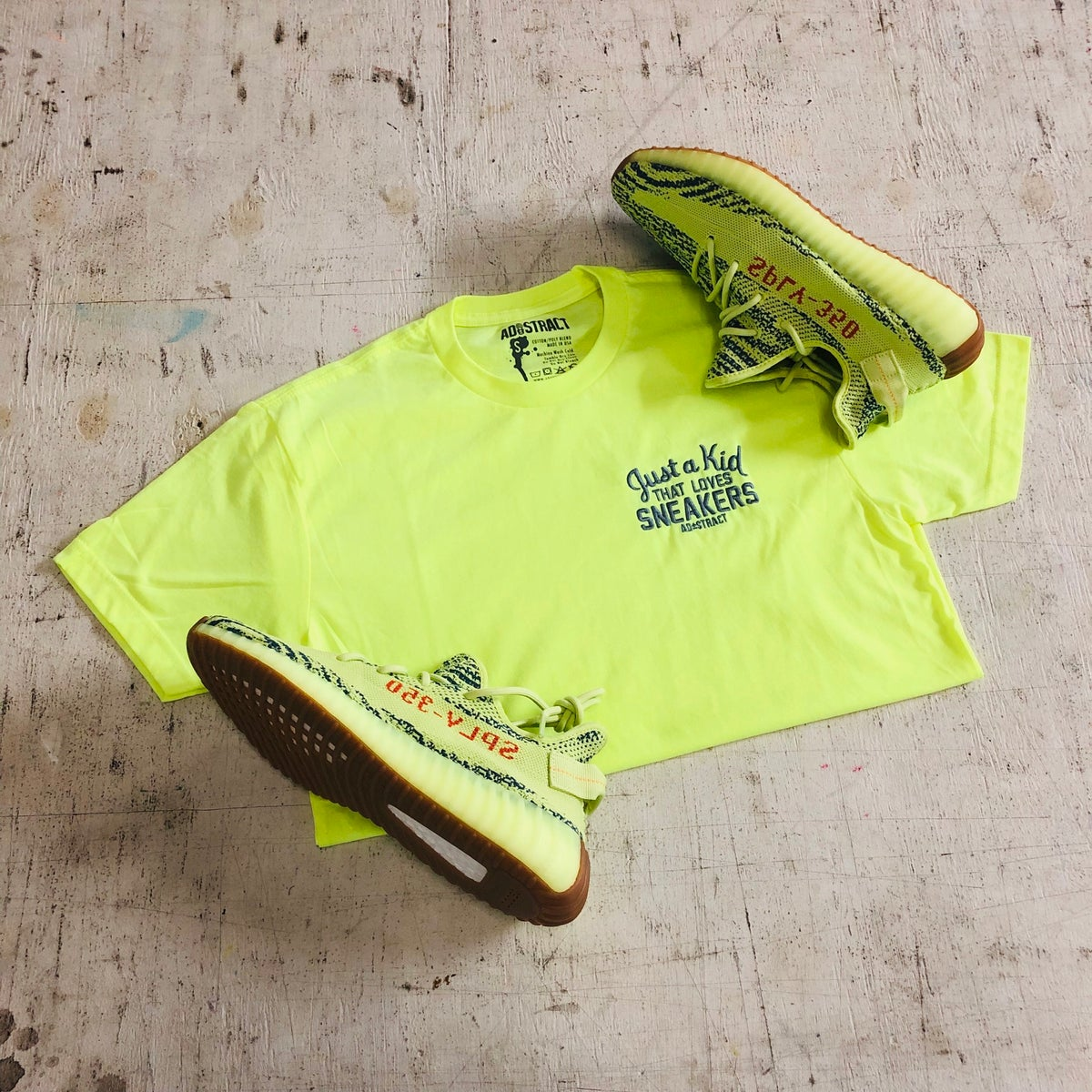 Image of JUST A KID THAT LOVES SNEAKER EMBROIDERY (NEON YELLOW) T-SHIRT