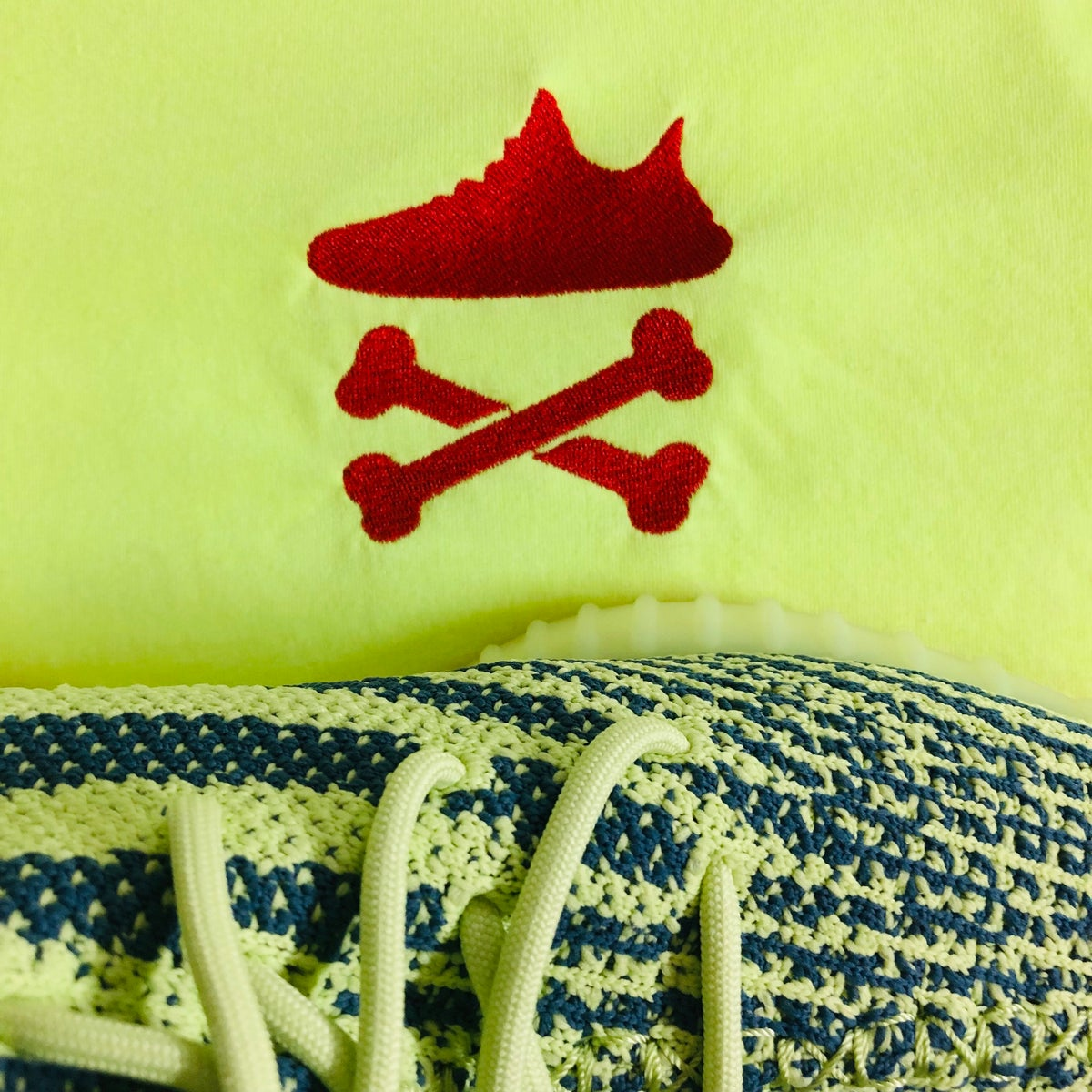 "Image of YEEZY CROSSBONES EMBROIDERY ""NEON YELLOW/ RED"" T-SHIRT"
