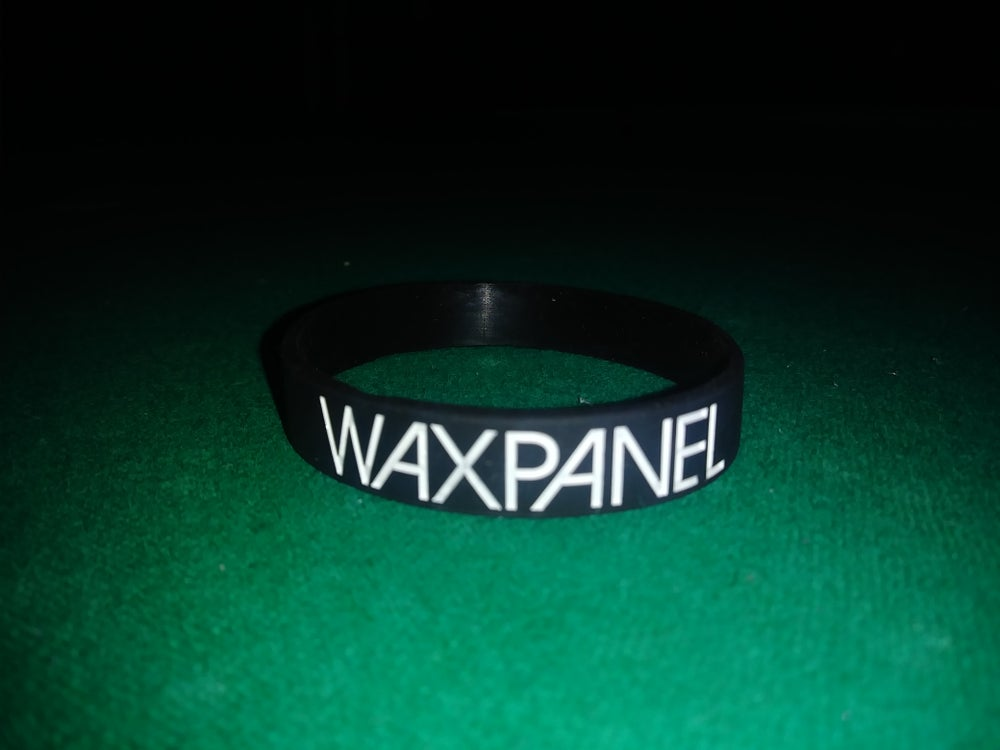 Image of WAXPANEL black wristband