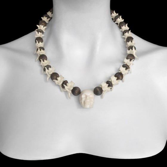 Image of Carved Skull and Rattlesnake Vertebrae Necklace
