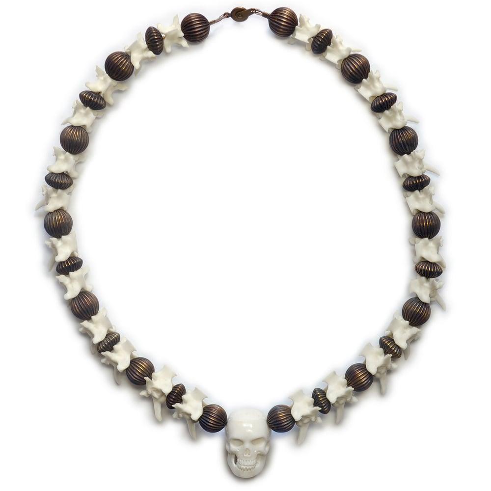 Image of Carved Skull and Rattlesnake Vertebrae Necklace