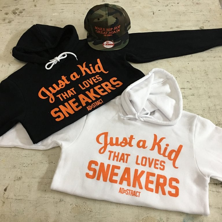 "Image of JUST A KID THAT LOVES SNEAKERS ""ORANGE PRINT"" T-SHIRT & HOODY"