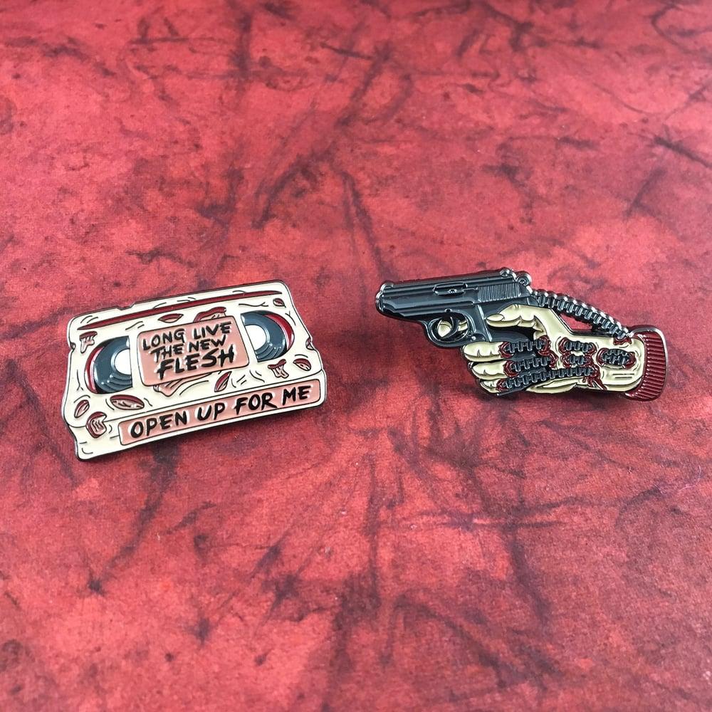 Image of Videodrome inspired flesh video cassette pin / gun hand pin