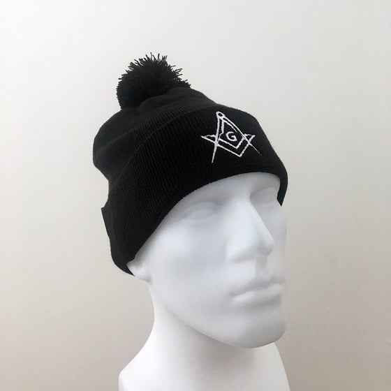 Image of Black knitted pom-pom hat