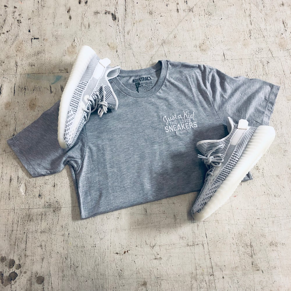 Image of JUST A KID THAT LOVES SNEAKERS EMBROIDERY LONG BODY T-SHIRT W/ SCALLOPED BOTTOM HEM