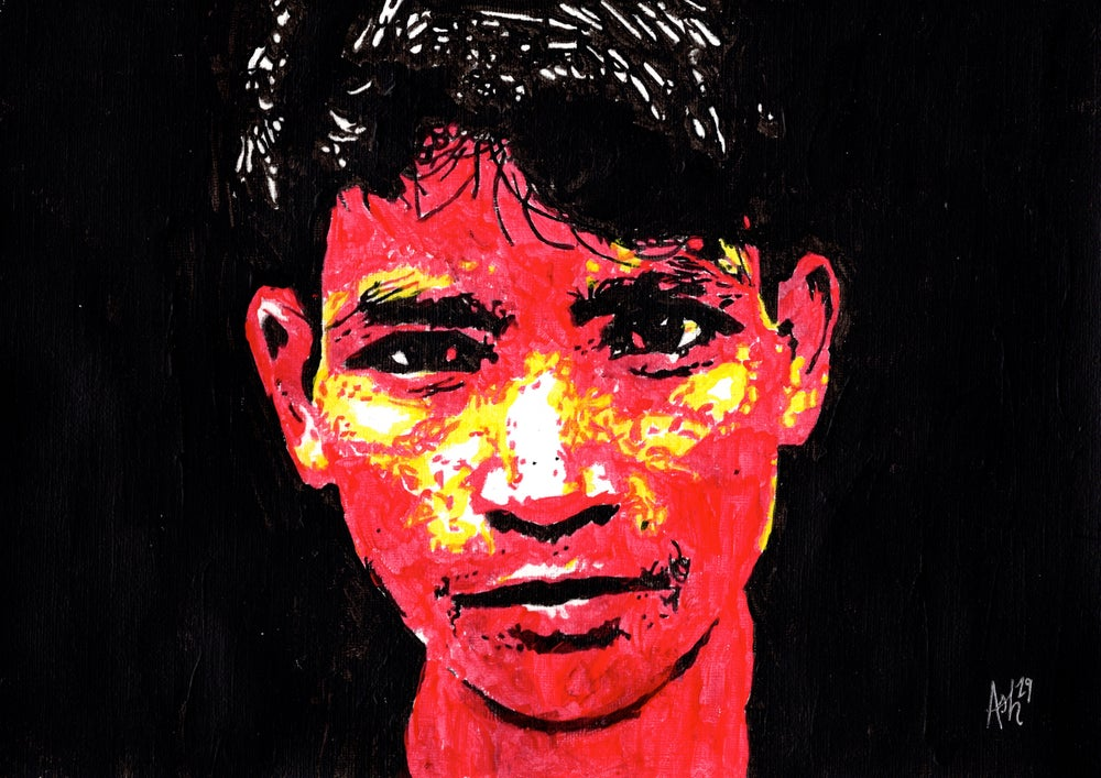 Image of Boy from India Staring