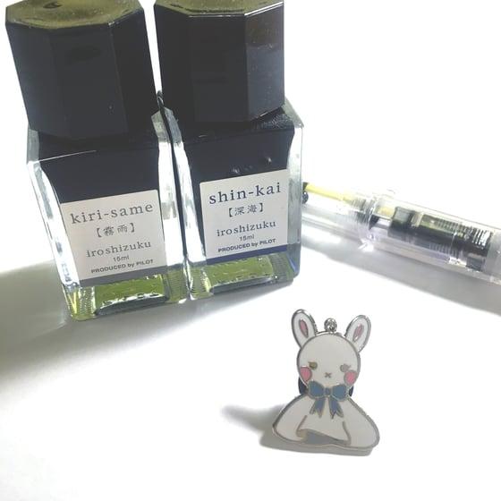 """Image of teru teru bunzu   1"""" enamel pin"""