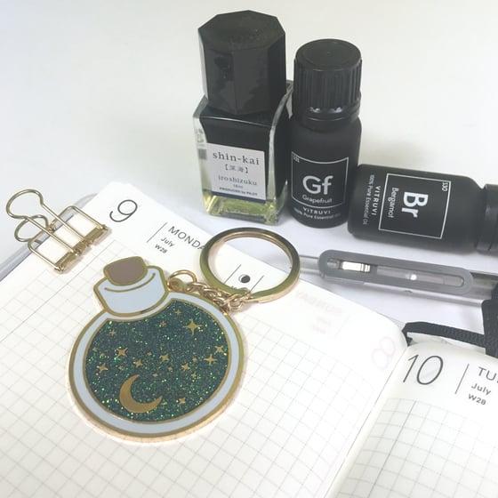 "Image of flask of ancient wisdom | 2"" enamel keychain"