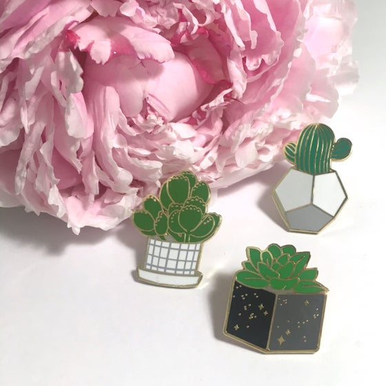 "Image of desert greenery | 1"" & 1.25"" enamel pins"