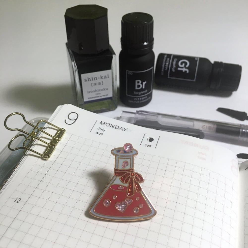 "Image of wizard's brews | 1"" & 1.25"" enamel pins"