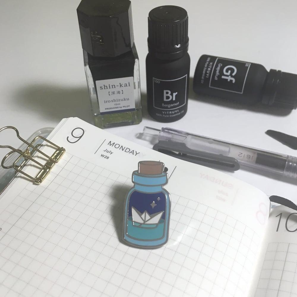 "Image of potion for safe passage | 1.25"" enamel pin"