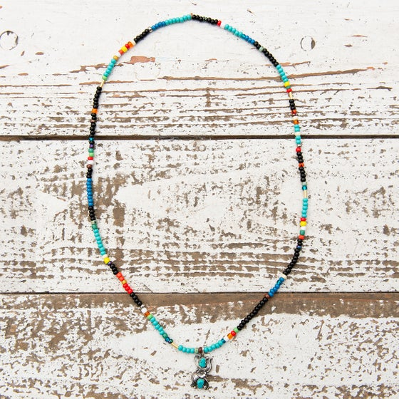Image of Coloured glass bead necklace and navajo pendant