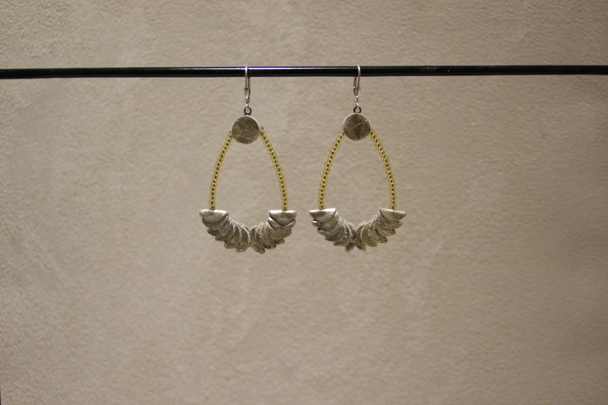 Image of boucles d'oreilles cuir or