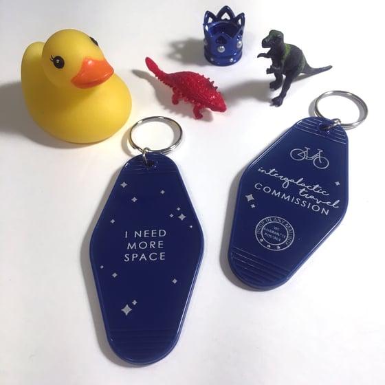 Image of intergalactic travel commission | acrylic keychain