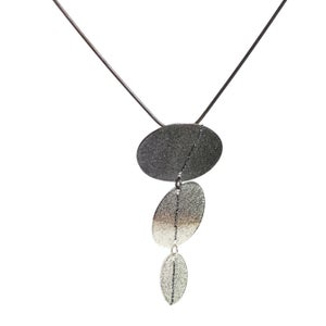 Image of 3 disc Sewn Up necklace