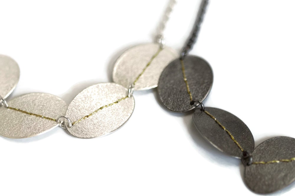 Image of Sewn Up 5 disc necklace