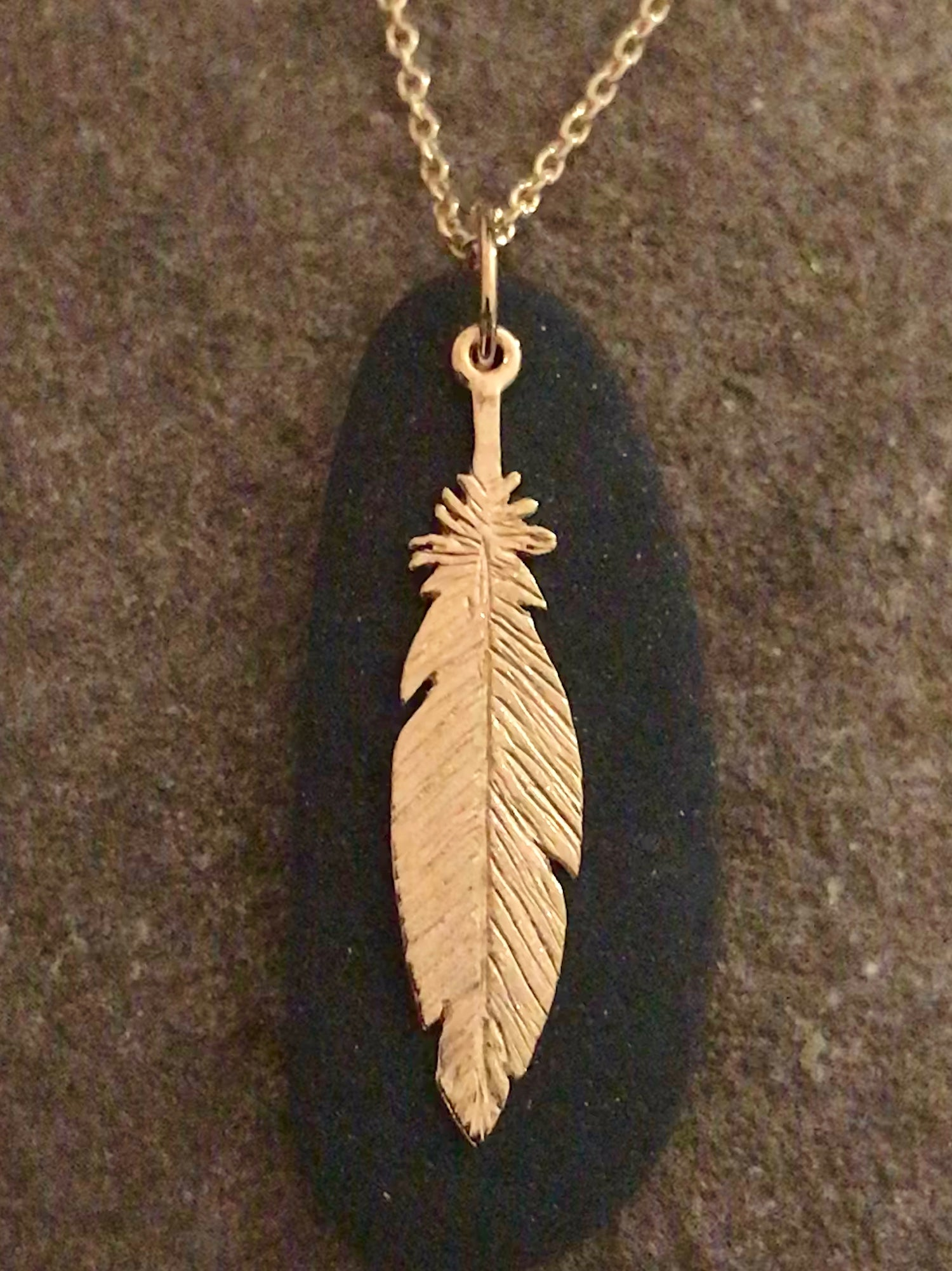 Image of 18K Gold Feather & Hudson River Rock Pendant