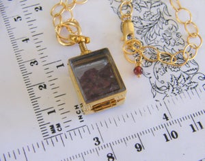 Image of Gold Floating Locket Choker Style with rough cut Umbalite Rhodolite Garnets