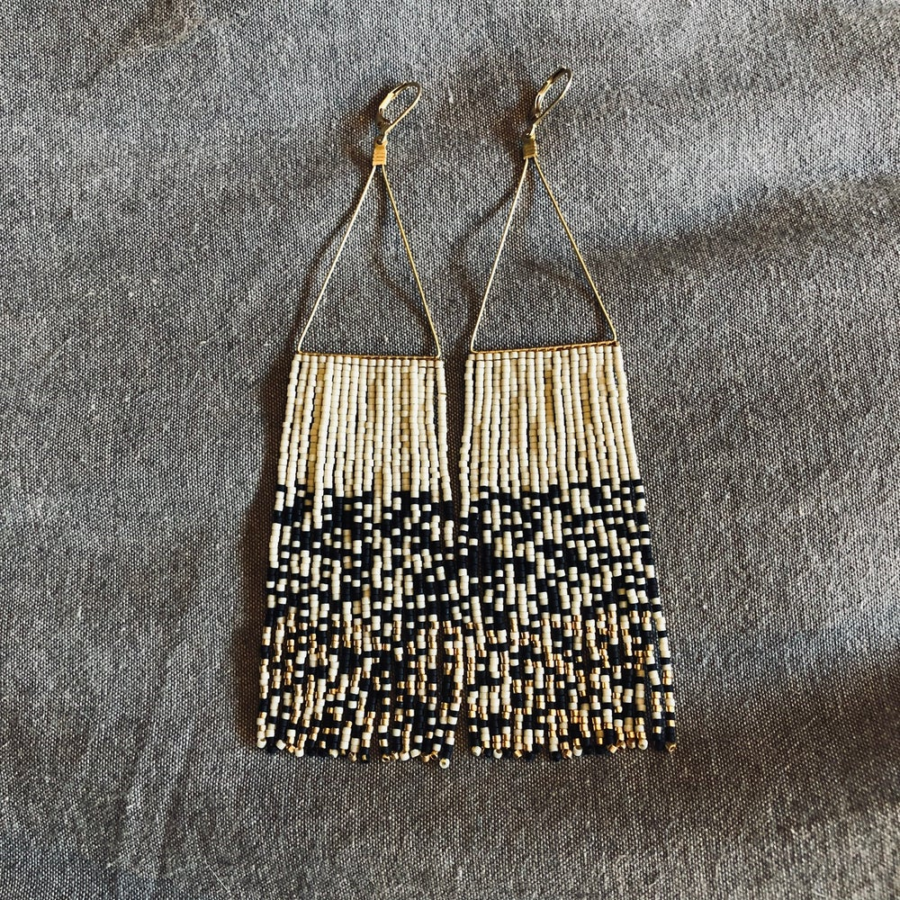 Image of Matte black, bone, and 24k gold chaos earrings