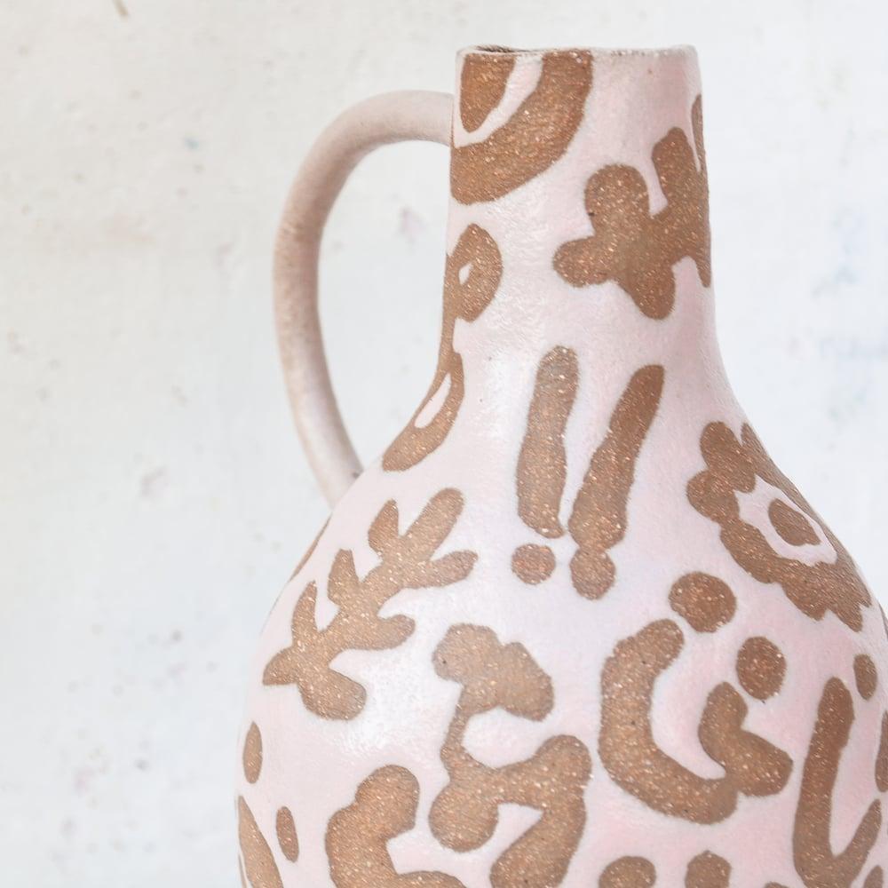 Image of pink banksia vase