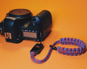 Image of Single strap with black carabiner clip slider for PD anchor link