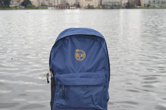 Image of The O Skyline Blue And Gold Back Pack