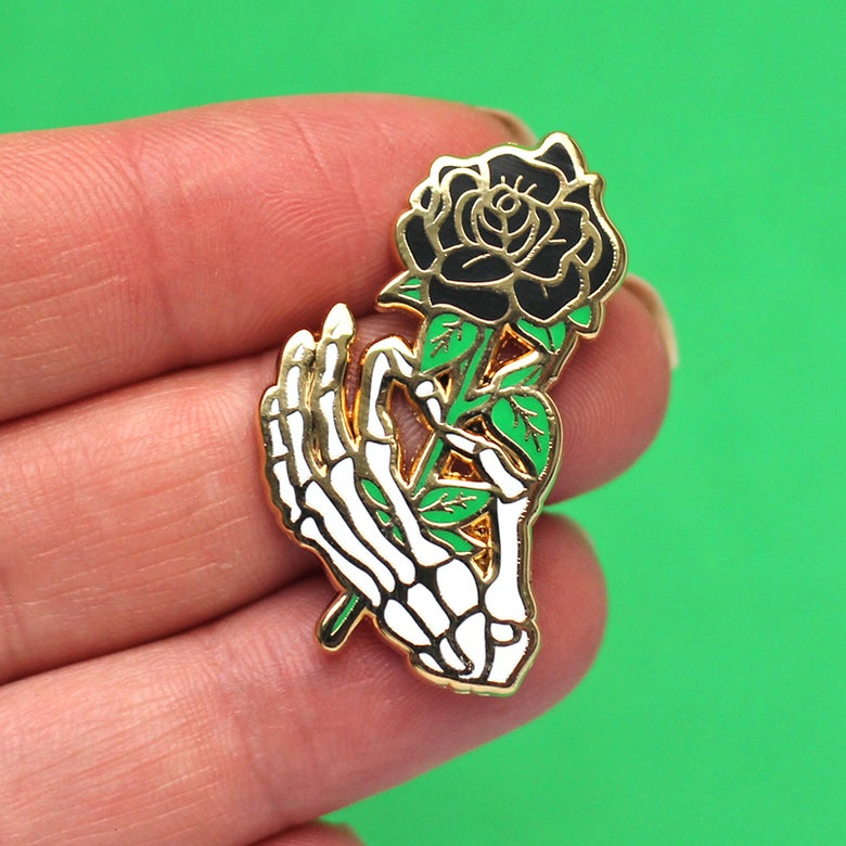 Image of Skeleton hand / black rose, enamel pin - bones - skeleton pin - anatomy - lapel pin badge