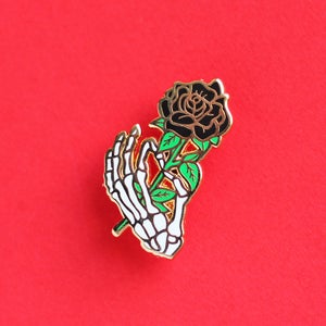 Image of Skeleton hand / black rose, enamel pin - bones - skeleton pin - anatomy - lapel pin badge
