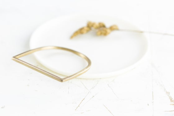 Image of Minimal D bangle . Two styles to choose from